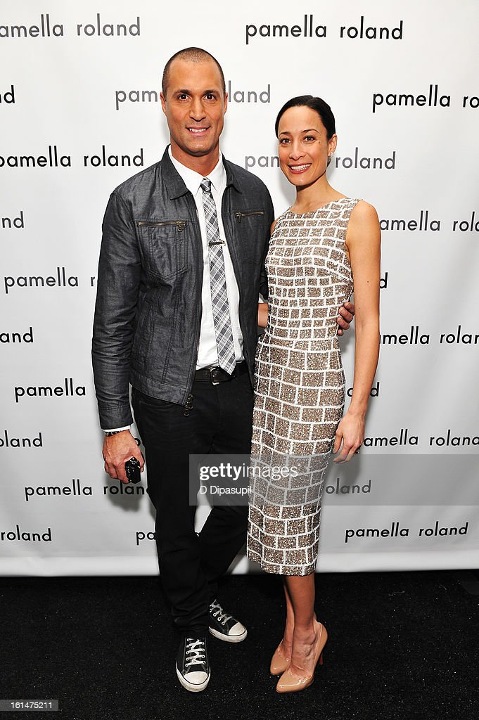 Photographer Nigel Barker and wife Cristen Barker pose backstage at the Pamella Roland Fall 2013 fashion show during Mercedes-Benz Fashion Week at at The Studio at Lincoln Center on February 11, 2013 in New York City.