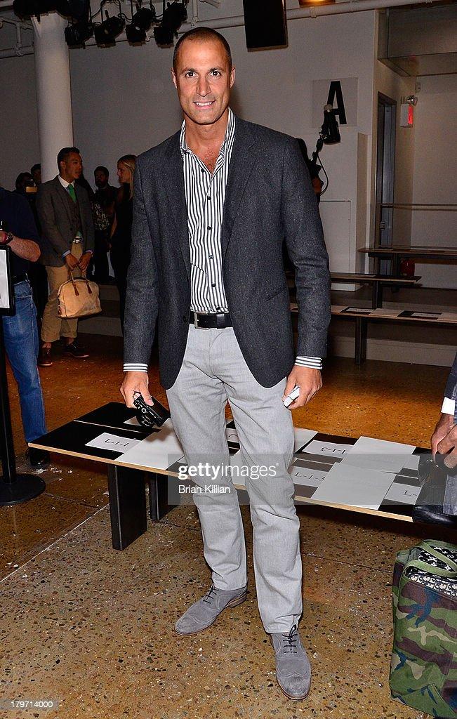 Photographer Nigel Barker attends the Cushnie Et Ochs show during Spring 2014 MercedesBenz Fashion Week at Milk Studios on September 6 2013 in New...