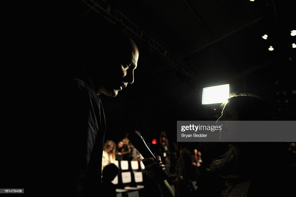 Photographer Nigel Barker gives an interview at the Pamella Roland 2013 Fall fashion show during Fall 2013 Mercedes-Benz Fashion Week at Lincoln Center for the Performing Arts on February 11, 2013 in New York City.