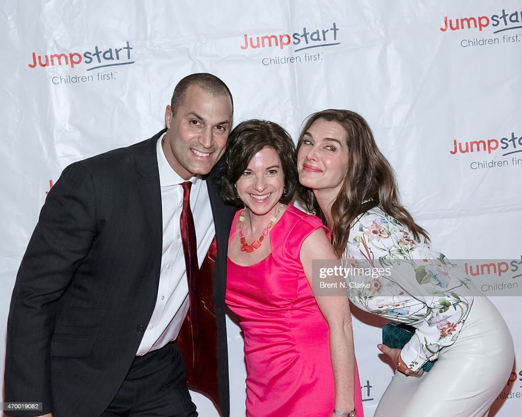 Photographer Nigel Barker, Jumpstart President and CEO Naila Bolus and actress Brooke Shields arrive for the Scribbles To Novels 10th Anniversary Gala held at Pier Sixty at Chelsea Piers on April 16, 2015 in New York City.
