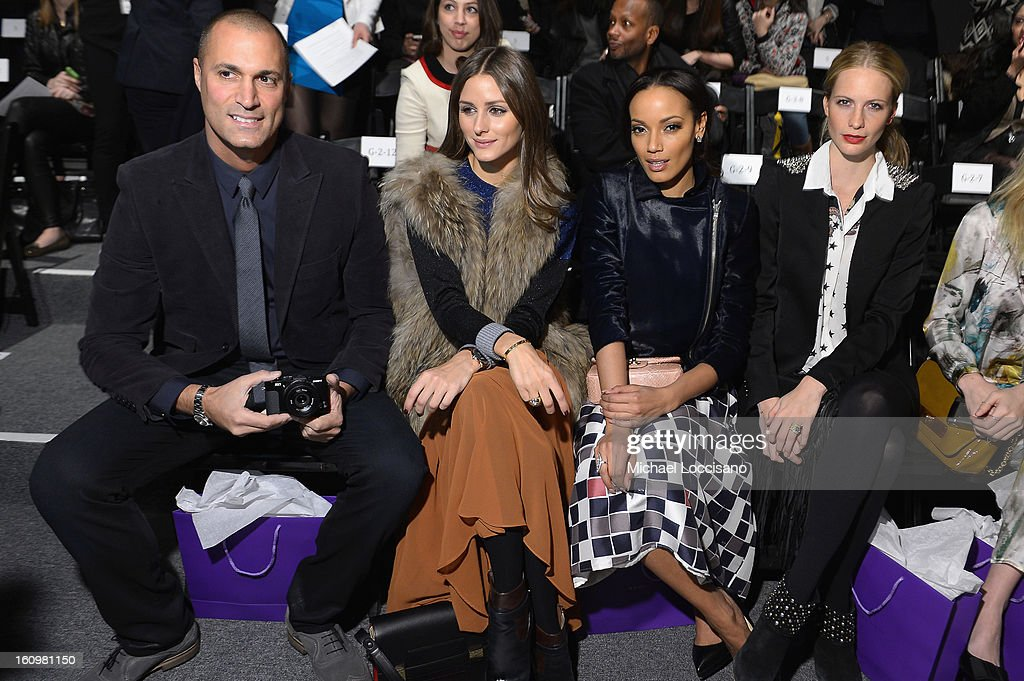 Photographer <a gi-track='captionPersonalityLinkClicked' href=/galleries/search?phrase=Nigel+Barker&family=editorial&specificpeople=691819 ng-click='$event.stopPropagation()'>Nigel Barker</a>, <a gi-track='captionPersonalityLinkClicked' href=/galleries/search?phrase=Olivia+Palermo&family=editorial&specificpeople=2639086 ng-click='$event.stopPropagation()'>Olivia Palermo</a>, Model <a gi-track='captionPersonalityLinkClicked' href=/galleries/search?phrase=Selita+Ebanks&family=editorial&specificpeople=619483 ng-click='$event.stopPropagation()'>Selita Ebanks</a> and Model <a gi-track='captionPersonalityLinkClicked' href=/galleries/search?phrase=Poppy+Delevingne&family=editorial&specificpeople=2348985 ng-click='$event.stopPropagation()'>Poppy Delevingne</a> attend the Noon By Noor Fall 2013 fashion show during Mercedes-Benz Fashion at The Studio at Lincoln Center on February 8, 2013 in New York City.