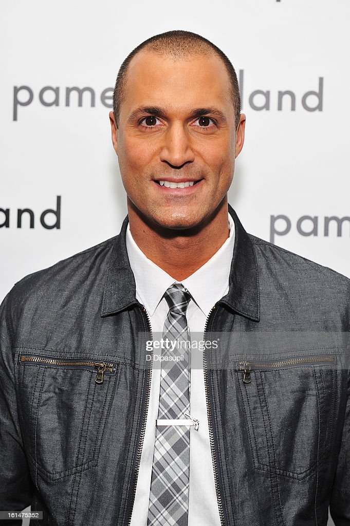 Photographer Nigel Barker poses backstage at the Pamella Roland Fall 2013 fashion show during Mercedes-Benz Fashion Week at at The Studio at Lincoln Center on February 11, 2013 in New York City.