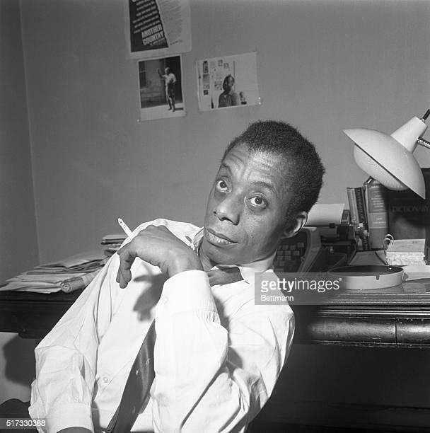 A photographer of author James Baldwin smoking a cigarette
