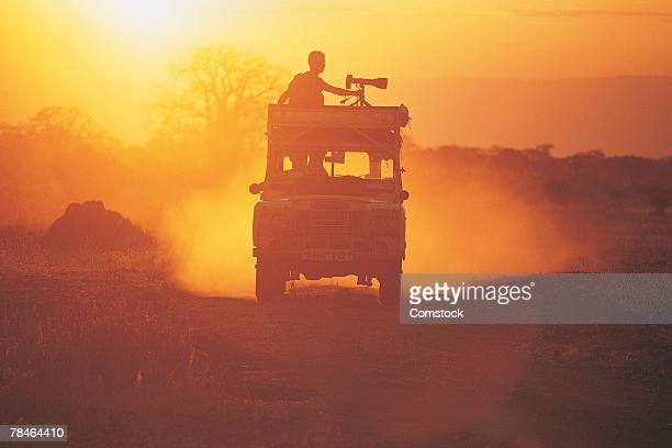 Photographer on top of truck