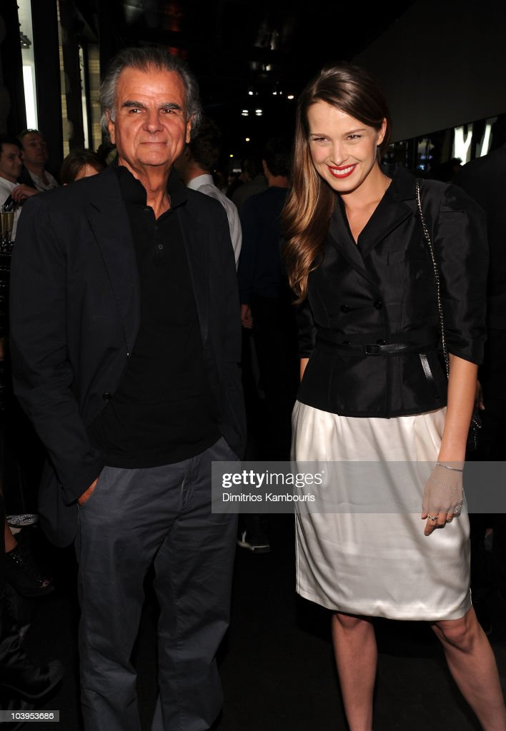 Photographer Patrick Demarchelier and model Petra Nemcova attends the reopening of the CHANEL SoHo Boutique at the Chanel Boutique Soho on September...