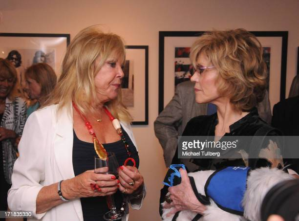 Photographer Pattie Boyd chats with actress Jane Fonda at an exhibition of Boyd's photographs entitled 'Pattie Boyd Newly Discovered' at Morrison...