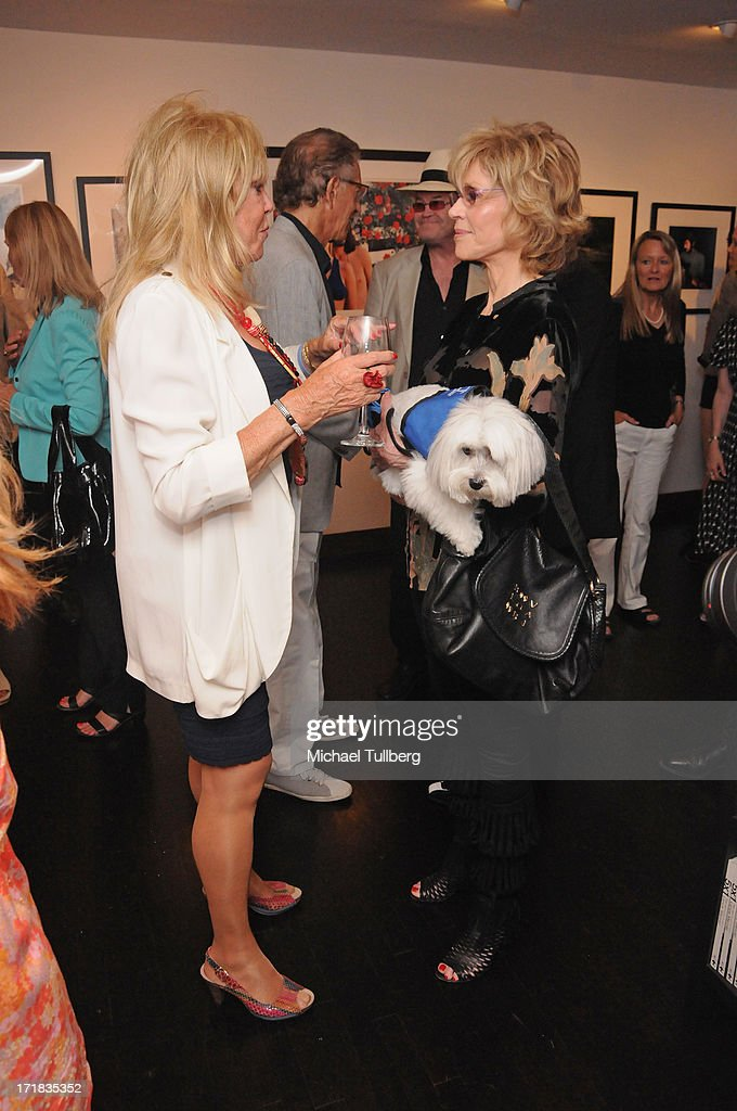 Photographer <a gi-track='captionPersonalityLinkClicked' href=/galleries/search?phrase=Pattie+Boyd&family=editorial&specificpeople=224054 ng-click='$event.stopPropagation()'>Pattie Boyd</a> chats with actress Jane Fonda at an exhibition of Boyd's photographs entitled '<a gi-track='captionPersonalityLinkClicked' href=/galleries/search?phrase=Pattie+Boyd&family=editorial&specificpeople=224054 ng-click='$event.stopPropagation()'>Pattie Boyd</a>: Newly Discovered' at Morrison Hotel Gallery on June 28, 2013 in West Hollywood, California.