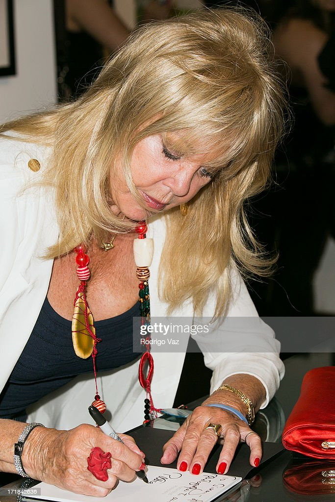 Photographer Pattie Boyd signs autographs at the Pattie Boyd: Newly Discovered Photo Exhibition at Morrison Hotel Gallery on June 28, 2013 in West Hollywood, California.