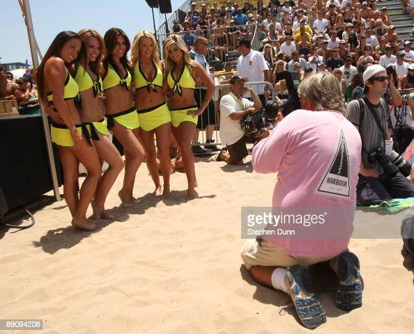 Photographer Peter Broulliet gets a shot of the AVP Dancers at the AVP Crocs Manhattan Beach Open on July 18 2009 in Manhattan Beach California