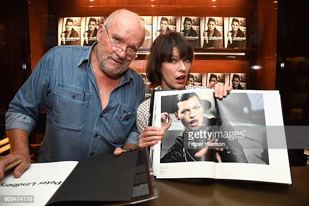 Photographer Peter Lindbergh and actress Milla Jovovich attend photographer Peter Lindbergh Book Signing for 'A Different Vision On Fashion...