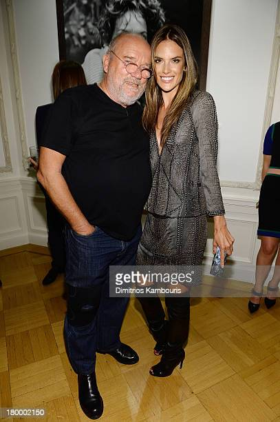 Photographer Peter Lindbergh and model Alessandra Ambrosio attend the Peter Lindbergh artist reception presented by Vladimir Restoin Roitfeld on...