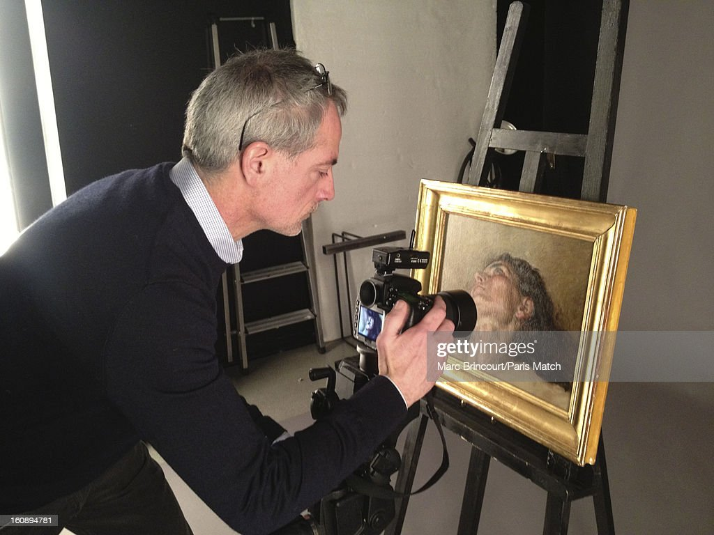 Photographer Philippe Petit is photographed, photographing the face of the woman who was famously painted for 'L'Origine du Monde' by Gustave Courbet for Paris Match on January 31, 2013 in Paris, France. PUBLISHED IMAGE. The face of the woman who was famously painted by Courbet and discover by John an art lover in a antique shop. After two years of investigation, the painting proved to be the missing part of the famous painting 'L'Origine du Monde' of Gustave Courbet.