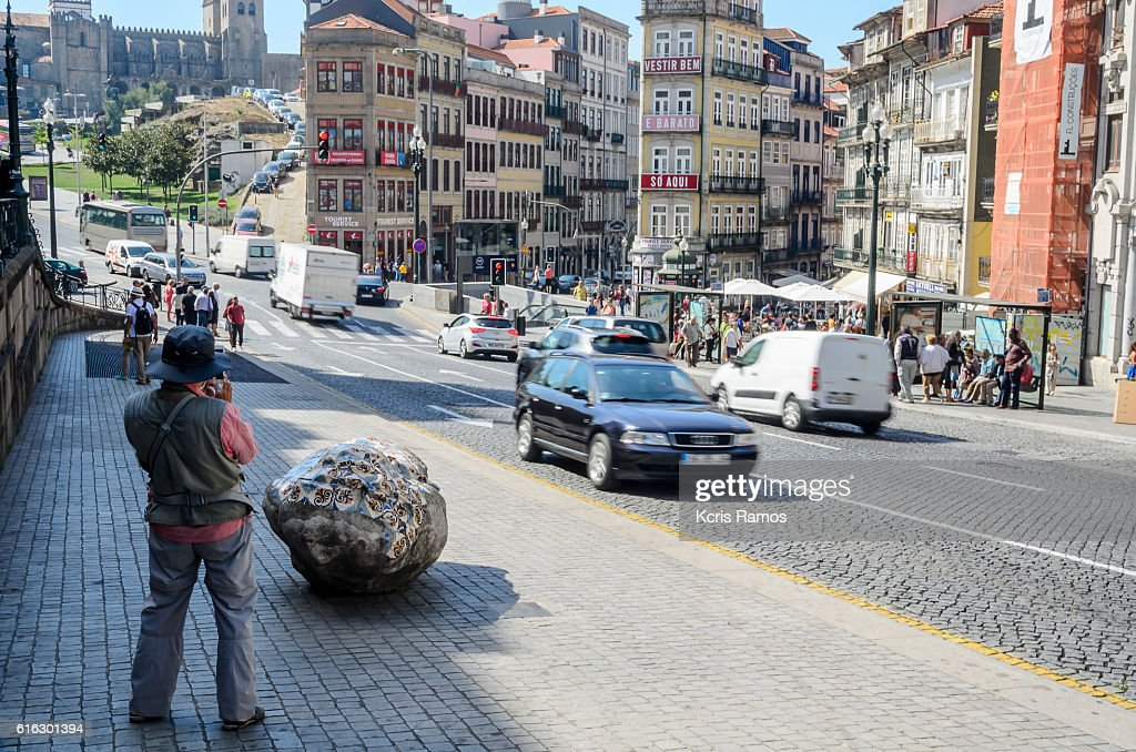 Photographer, photographing Clerigos street in Porto Portugal : Stock Photo