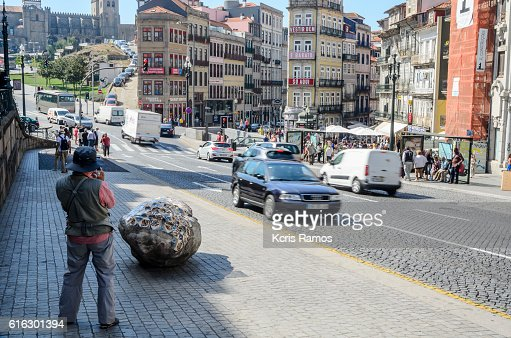Photographer, photographing Clerigos street in Porto Portugal : Stock Photo