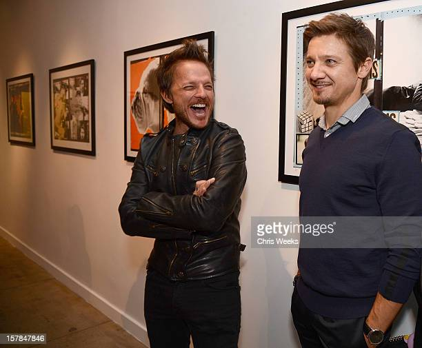 Photographer Randall Slavin and actor Jeremy Renner attend the opening of 'Wetdreams' at Gallery Brown on December 6 2012 in Los Angeles California