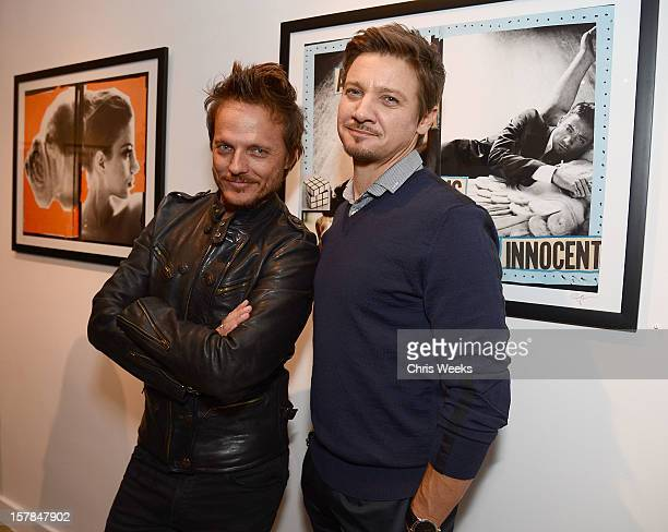 Photographer Randall Slavin and actor Jeremy Renner attends the opening of 'Wetdreams' at Gallery Brown on December 6 2012 in Los Angeles California