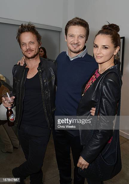 Photographer Randall Slavin and actors Jeremy Renner and Rachael Leigh Cook attend the opening of 'Wetdreams' at Gallery Brown on December 6 2012 in...