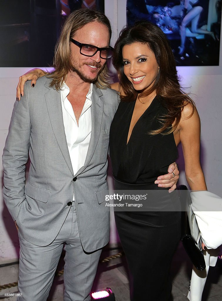 Photographer Randall Slavin and Actress Eva Longoria attend Moments In Motion, An Exclusive Unveiling Of Never Before Seen Photos At De Nolet, Miami For Art Basel on December 5, 2013 in Miami, Florida.