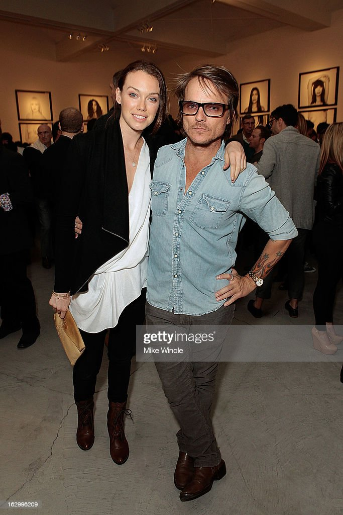 Photographer Randall Slavin (R) and model Jamie Vandyke attend the Samuel Bayer Ace Gallery Exhibit Opening, presented by Panavision at Ace Gallery on March 2, 2013 in Beverly Hills, California.