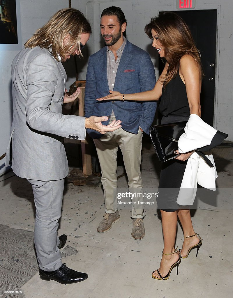 Photographer Randall Slavin, Jose Antonio Baston, and Actress Eva Longoria attend Moments In Motion, An Exclusive Unveiling Of Never Before Seen Photos At De Nolet, Miami For Art Basel on December 5, 2013 in Miami, Florida.