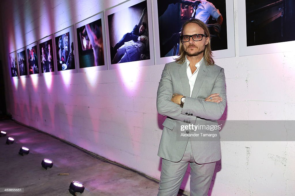 Photographer Randall Slavin poses in front of his photos at Moments In Motion, An Exclusive Unveiling Of Never Before Seen Photos At De Nolet,Miami For Art Basel on December 5, 2013 in Miami, Florida.