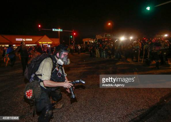 A photographer reacts during a protest on August 18 2014 for Michael Brown who was killed by a police officer on August 9 in Ferguson United States...