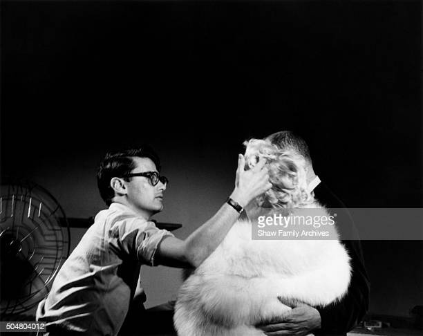 Photographer Richard Avedon works on Marilyn Monroe's hair for a publicity shoot with Director Billy Wilder for 'The Seven Year Itch' in 1954 in New...