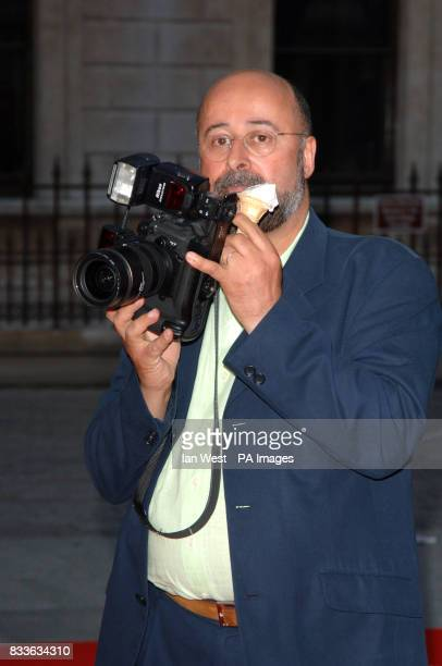 Photographer Richard Young eats an icecream at the Royal Academy Summer Exhibition 2006 preview party at the Royal Academy of Arts central London
