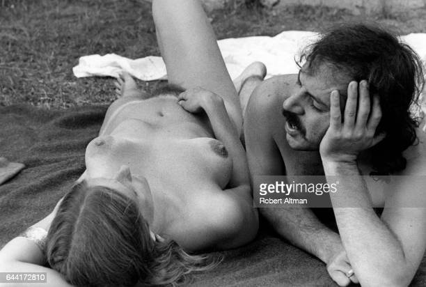 Photographer Robert Altman and Detroit Annie lay naked near a pond during The Alternative Media Conference on June 1720 1970 at Goddard College in...
