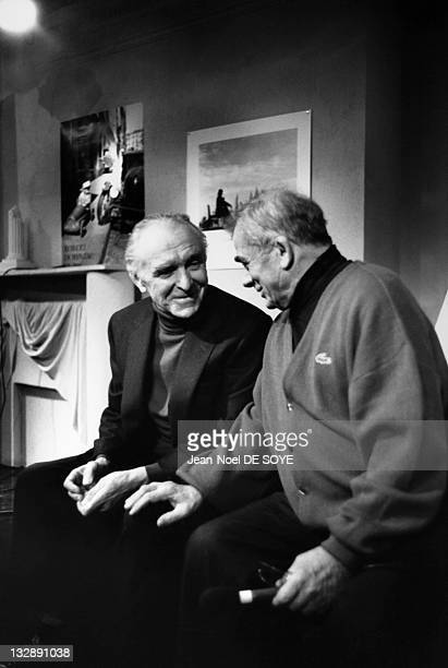 Photographer Robert Doisneau and actor Maurice Baquet on the set of TV show 'Du Cote De Chez Fred' during 1988 in Paris France