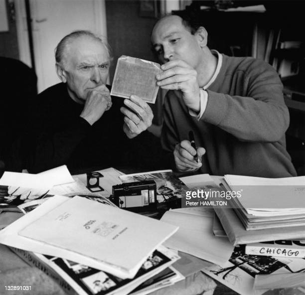 Photographer Robert Doisneau and Peter Hamilton looking at photographs during 1993 in France