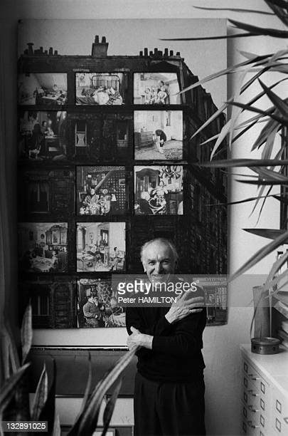 Photographer Robert Doisneau poses at home during October 1992 in Montrouge Hauts de Seine France Robert Doisneau stands in front of one of his...