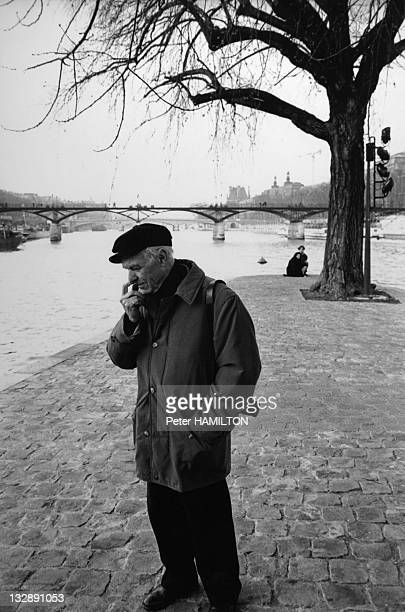 Photographer Robert Doisneau walking with his camera in the Square du Vert Galant on on February 16 1993 in Paris France