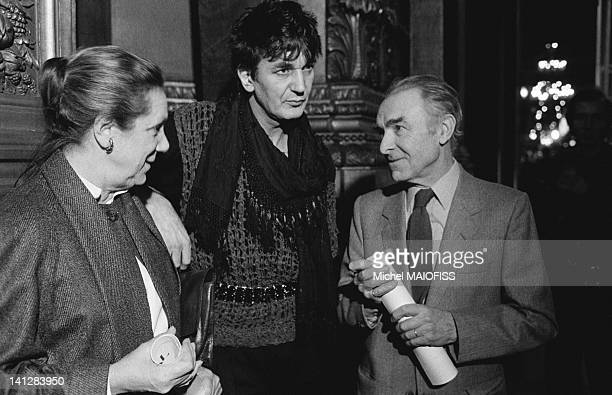 Photographer Robert Doisneau with actress Denise Gence and singer Jacques Higelin at the Grand Prix de la Ville de Paris awards ceremony on December...