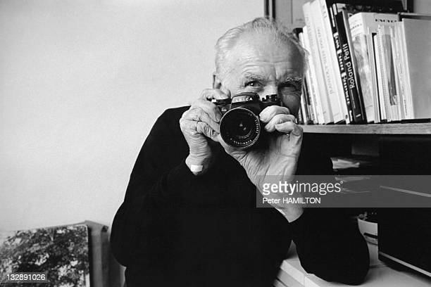 Photographer Robert Doisneau with his Leica camera at home during 1992 in Montrouge Hauts de Seine France