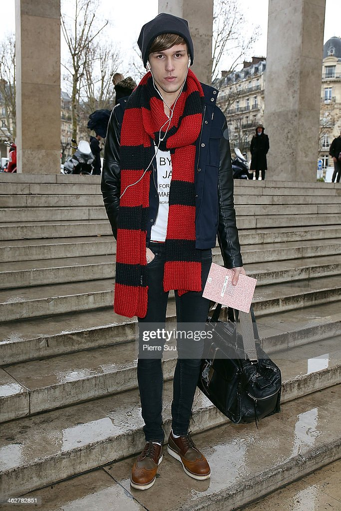 Photographer Sacha wears a Marc Jacobs shirt,Hugo Boss Bag,Zara Scarf,Zara Jacket on January 15, 2014 in Paris, France.
