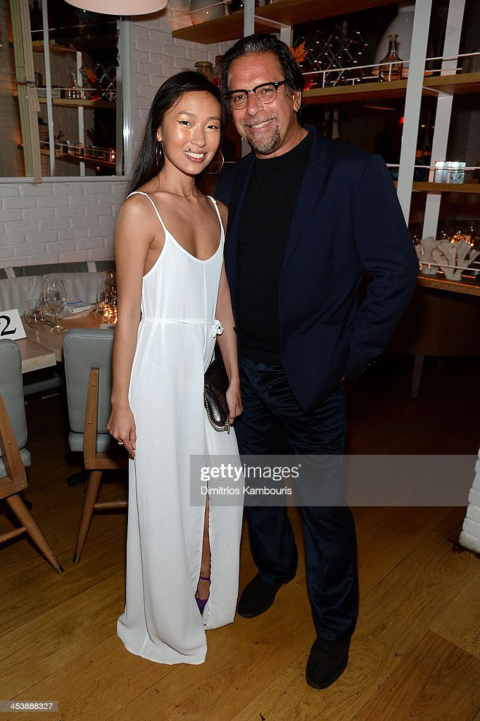 Photographer Sante D'Orazio (R) and Enga Purevjav attend the Aby Rosen & Samantha Boardman Dinner at The Dutch on December 5, 2013 in Miami Beach, Florida.