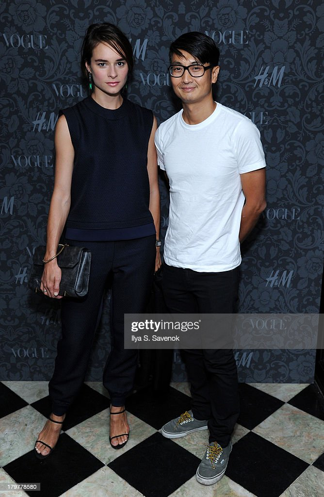 Photographer Sebastian Kim (R) and his wife attend H&M & Vogue Studios Celebrate 'Between The Shows' on September 6, 2013 in New York City.