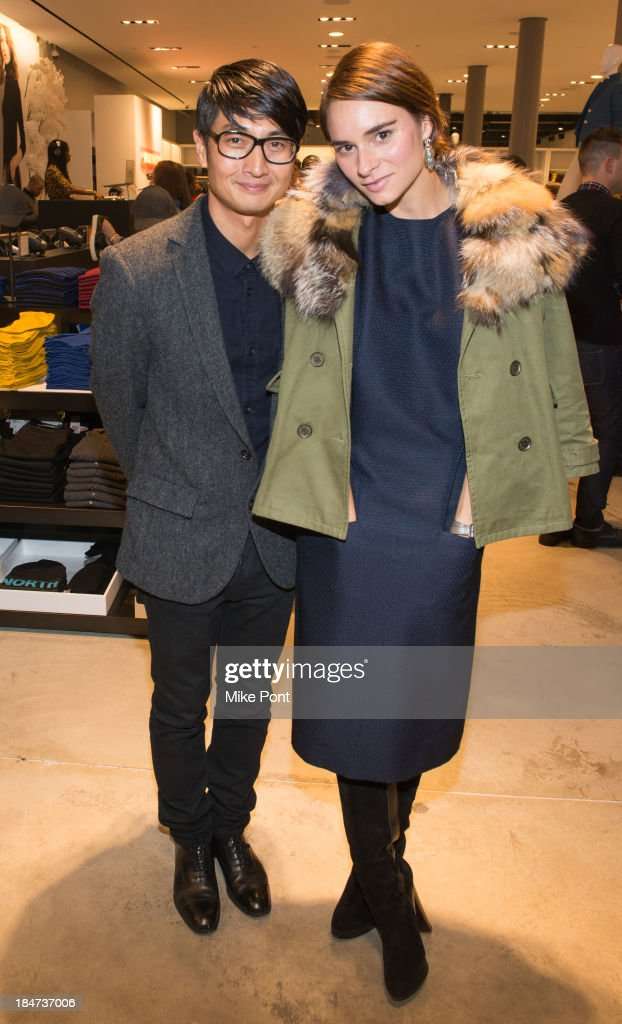 Photographer Sebastian Kim and Marina Munoz attend the Joe Fresh Soho opening party at Joe Fresh Soho on October 15 2013 in New York City