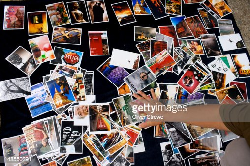Photographer selling postcards at the Saturday Walking Market. : Stock Photo