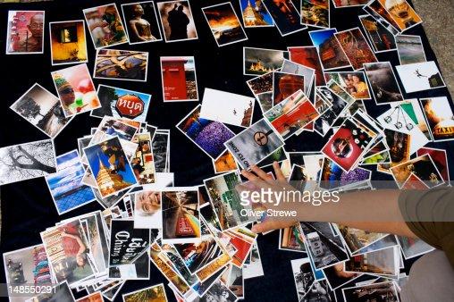 Photographer selling postcards at the Saturday Walking Market. : Bildbanksbilder