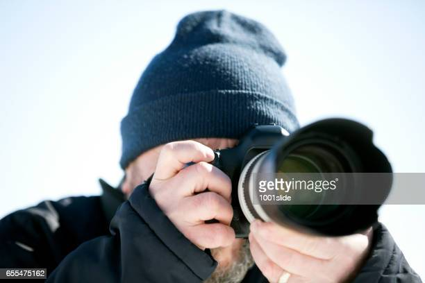 Photographer shooting at cold
