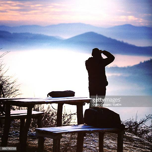 Photographer Shooting Mountains At Sunrise