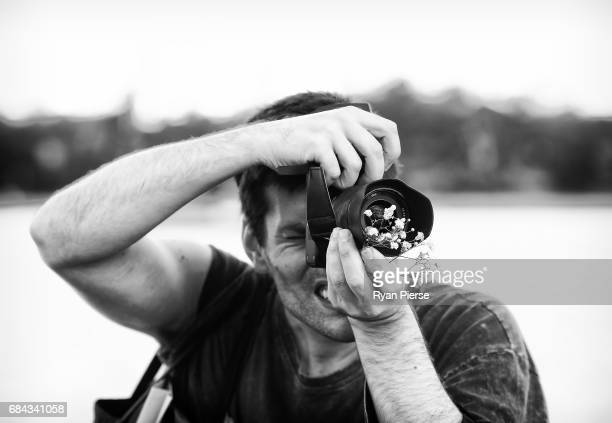 A photographer shoots at the Dyspnea show at MercedesBenz Fashion Week Resort 18 Collections at on Sydney Harbour on May 18 2017 in Sydney Australia