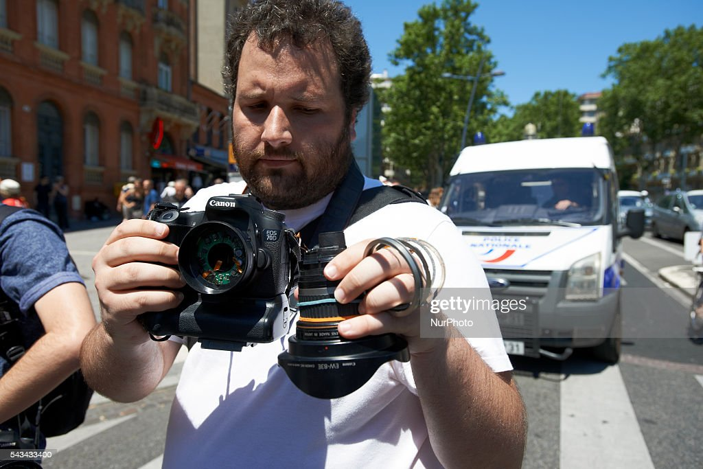 A photographer shows his lens broken by riot police at the end of the protest against the El-Khomri bill on labour reforms the day the bill go through the Senate. Demonstrators also protest against the use of article 49.3 which bypass the Parliament . Toulouse. France. June 28th, 2016.