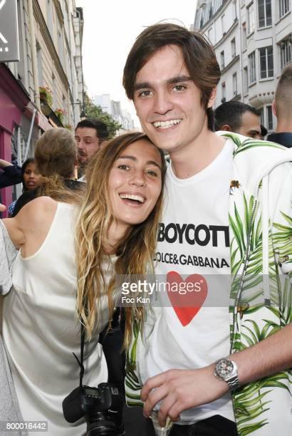 Photographer Sidney Carron and Alain Fabien Delon attend the MX Paris Max Simoens Flagship Opening Show Party as part of Paris Fashion Week on June...
