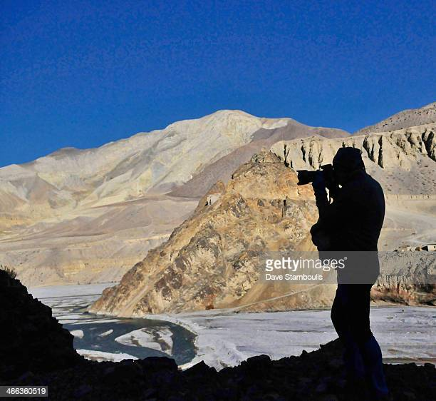 CONTENT] photographer silhouette looking up the Kali Gandaki River into the Kingdom of Mustang in the Annapurna region of Nepal