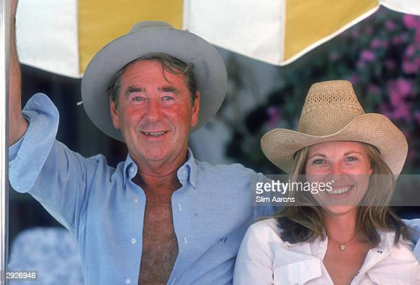 Photographer Slim Aarons with Anne Klehe in Sotogrande Spain September 1975