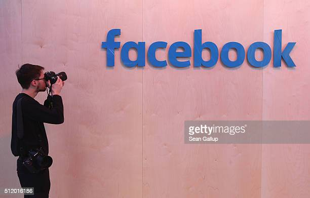 A photographer snaps a photo of the Facebook logo at the Facebook Innovation Hub on February 24 2016 in Berlin Germany The Facebook Innovation Hub is...