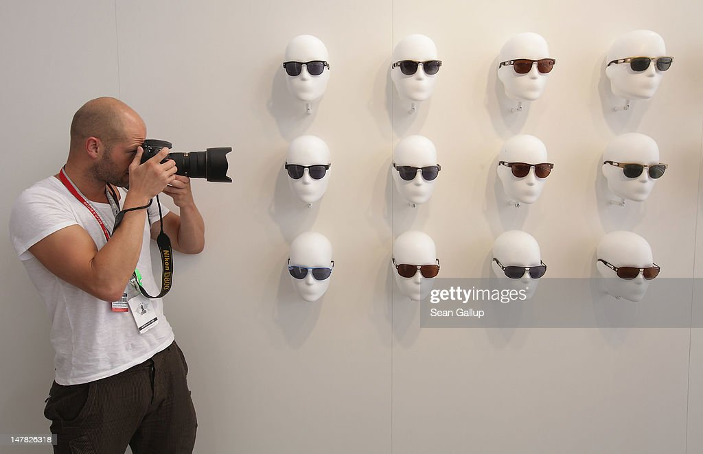 A photographer snaps a picture among sunglasses on display at the adidas Originals Spring/Summer 13 collection at the Bread and Butter 2012 fashion trade fair on July 4, 2012 in Berlin, Germany.